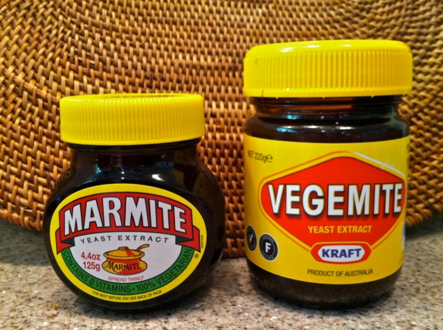 "In a rare moment of harmony, Marmite and Vegemite agree to pose together for a photo. By the way—that thing labeled ""marmite"" on the Marmite label? It's a marmite, a French cooking pot, whence comes the name."
